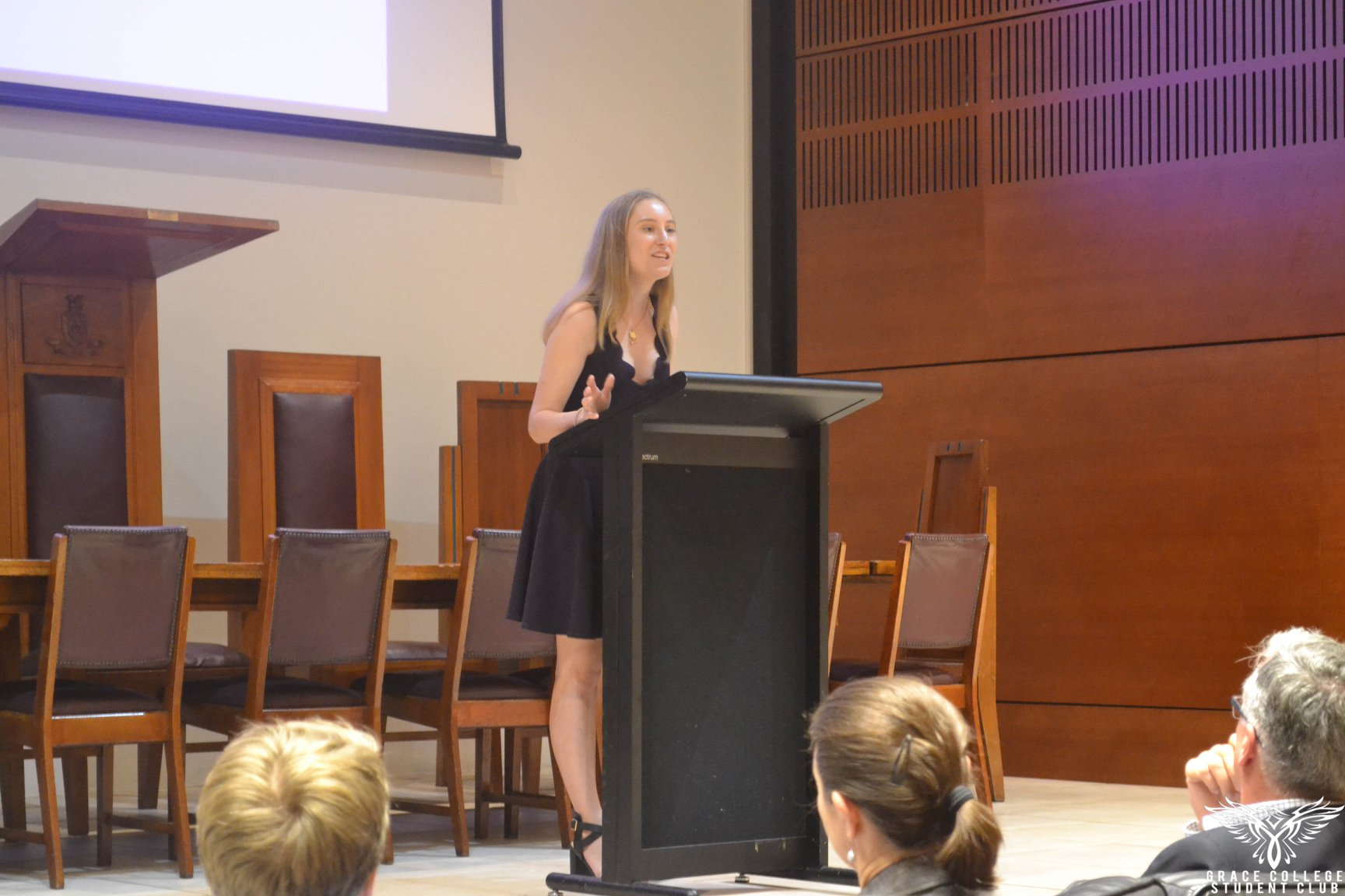 Oratory competitor speaking at a lectern