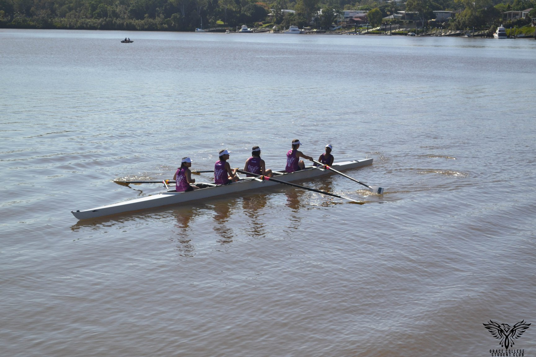 A rowing crew on the water