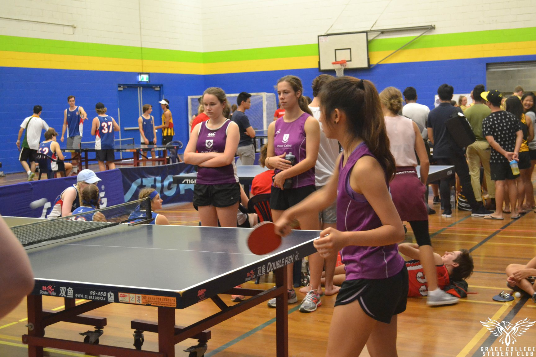 Playing table tennis watched by supporters