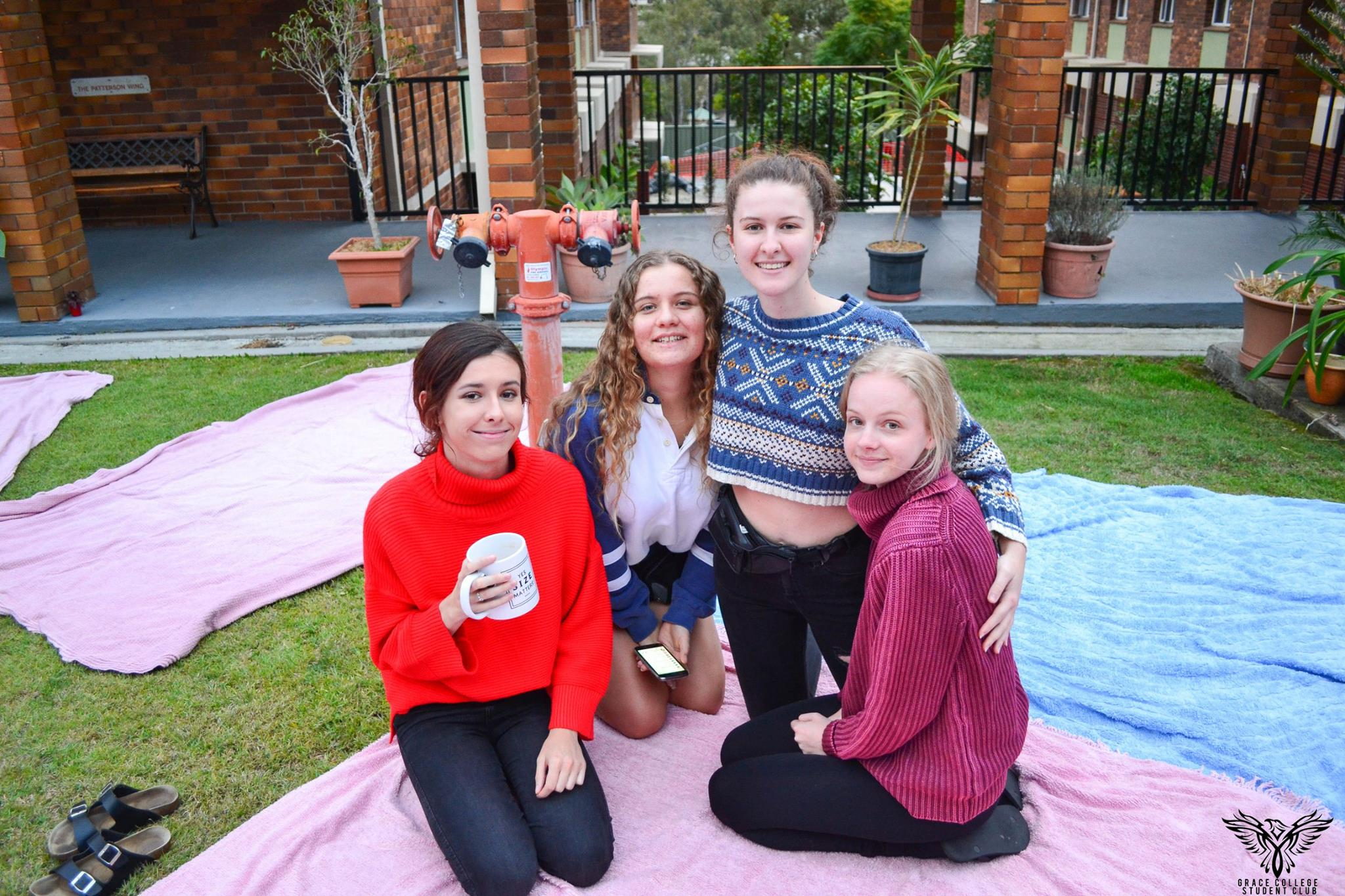 Group of residents on picnic blankets in the central courtyard