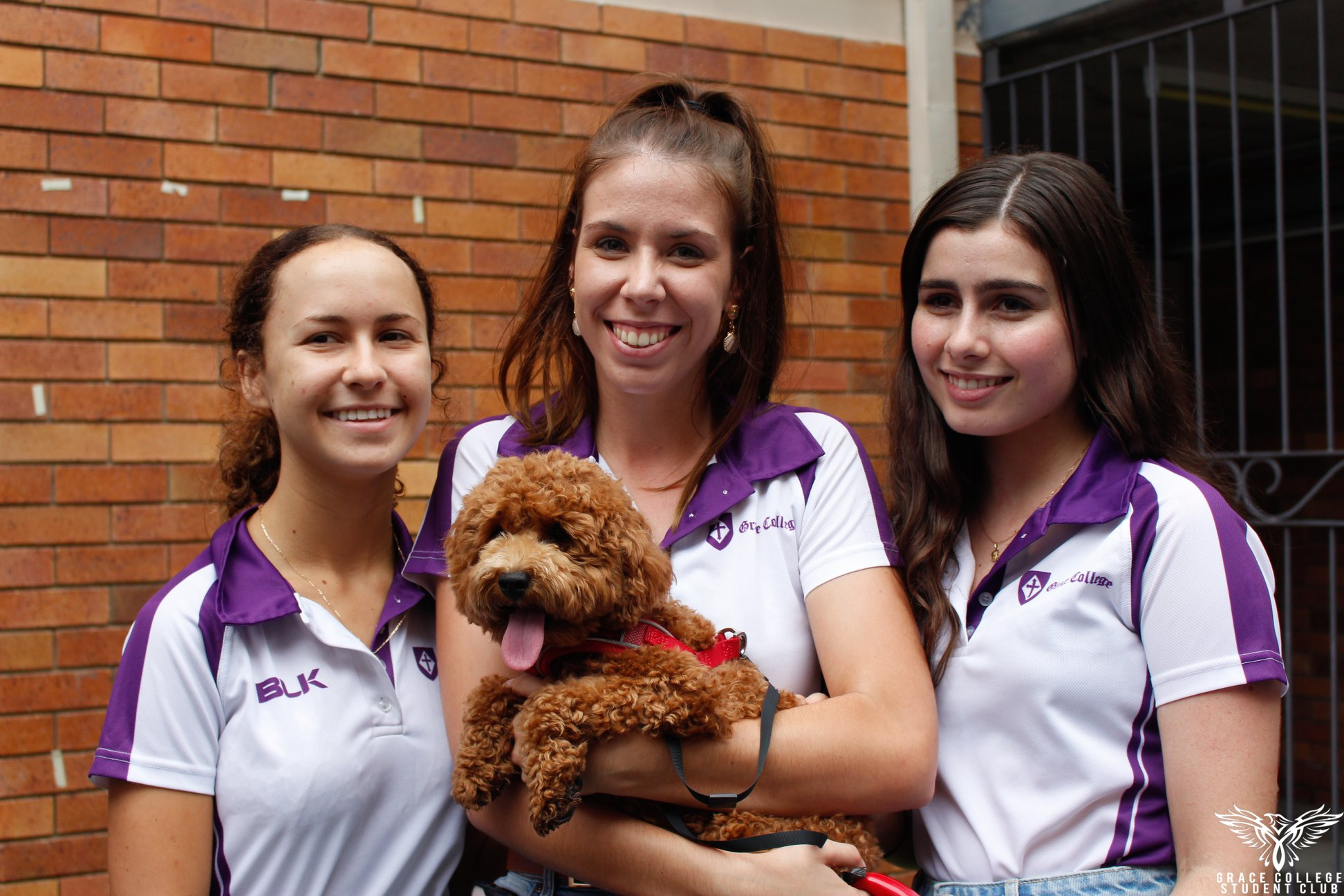 Student leaders with fluffy dog