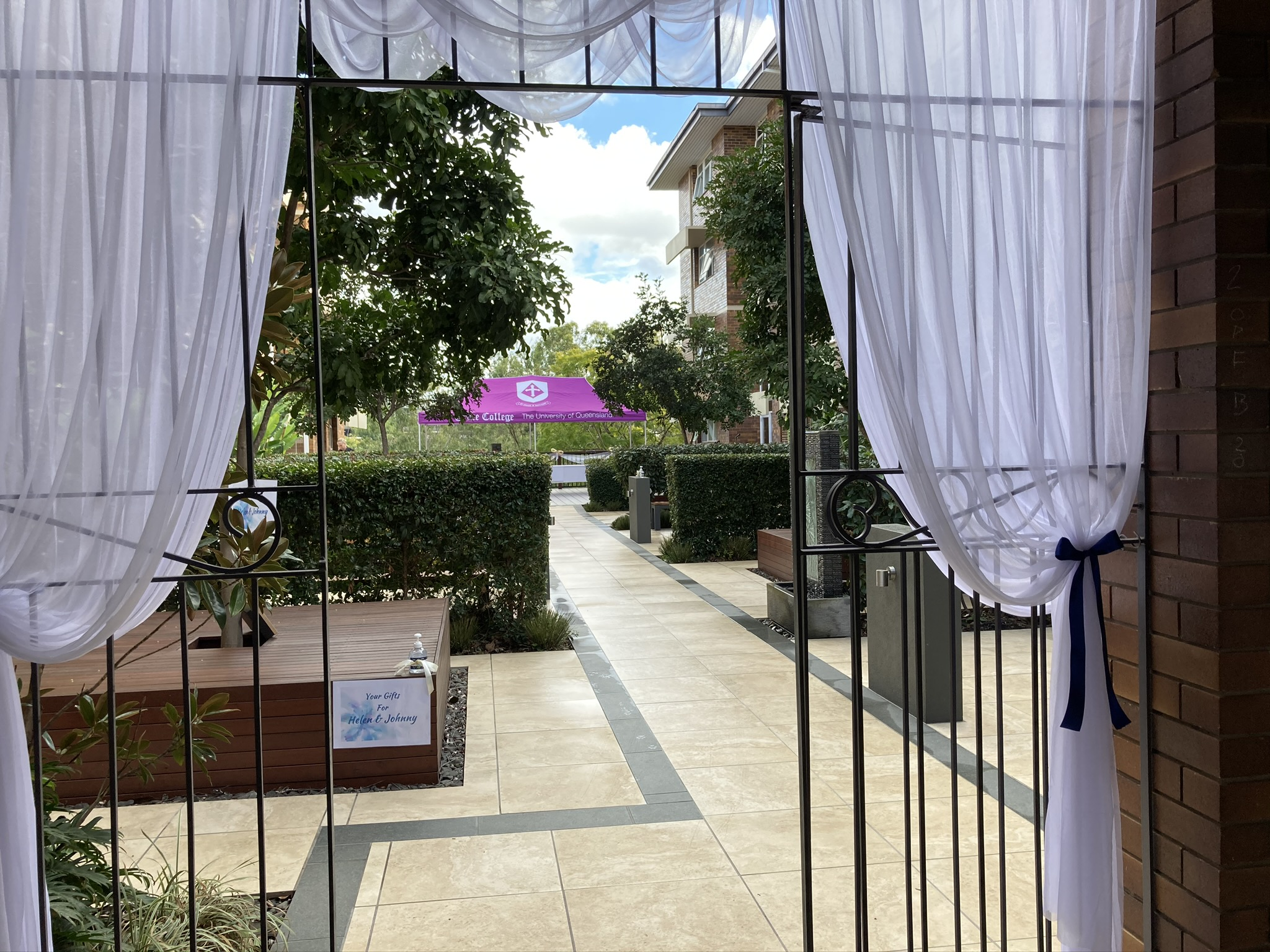Looking through curtained entry into outdoor area